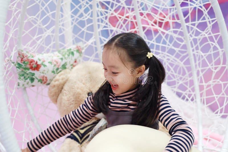 Beautiful cheerful little girl playing pleasure ground on playground stock photos
