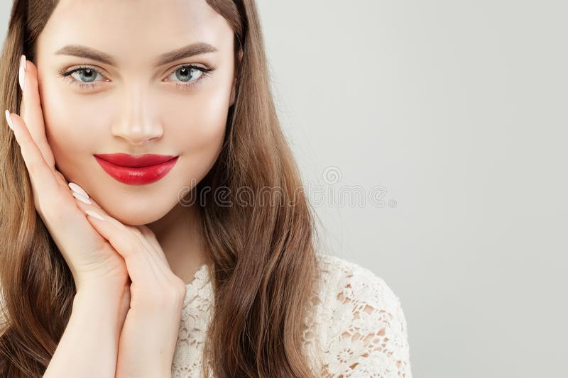 Beautiful cheerful woman model with clear skin and red lips makeup stock image