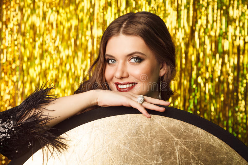 beautiful cheerful woman in party on sparkling background stock photo