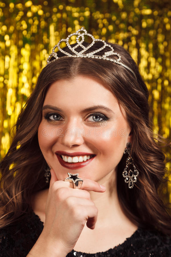 beautiful cheerful woman in party on sparkling background royalty free stock image