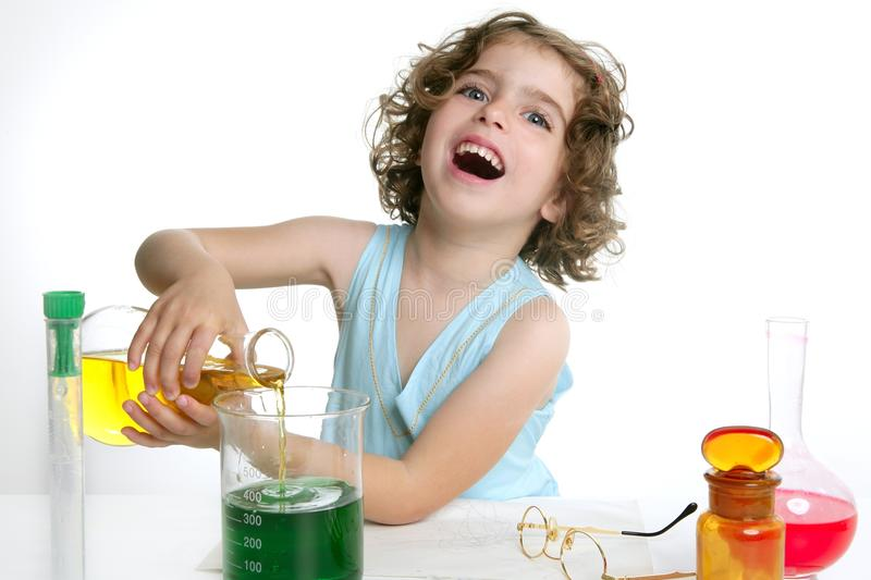 Beautiful chemistry little girl playing in lab royalty free stock photography