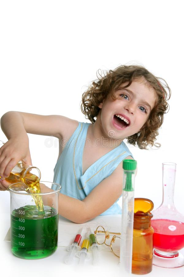 Beautiful chemistry little girl playing in lab stock photography