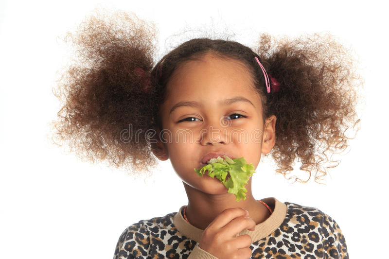 Beautiful child asian Afro American child salad royalty free stock image