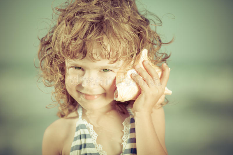 Beautiful child at the beach stock images