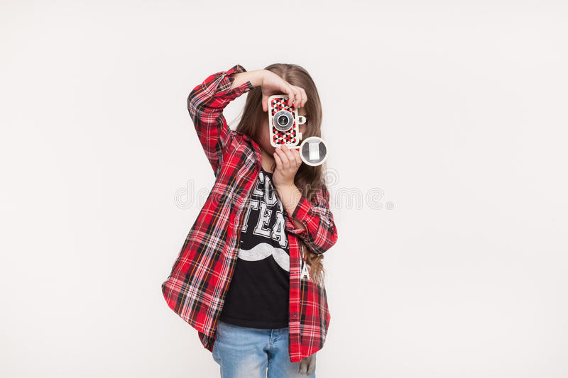 Beautiful child girl holding a instant camera stock photos