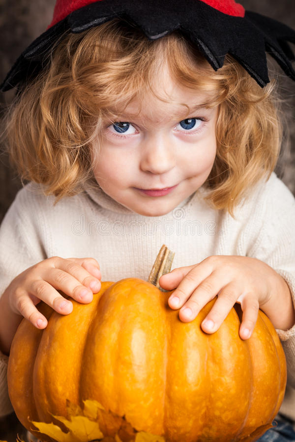 Download Beautiful Child Holding A Pumpkin Stock Photography - Image: 25309762