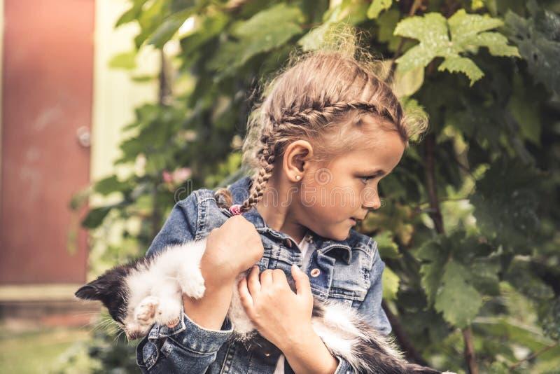 Beautiful child kid girl playing pet kitty concept animals care. Beautiful cute child kid girl playing pet kitty concept animals care stock photos