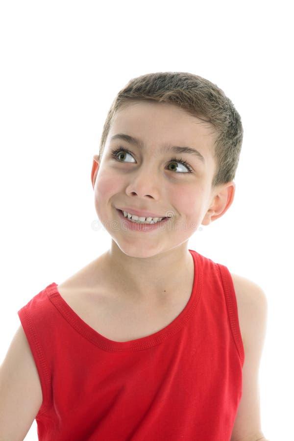 Beautiful child looking sideways smiling royalty free stock photos