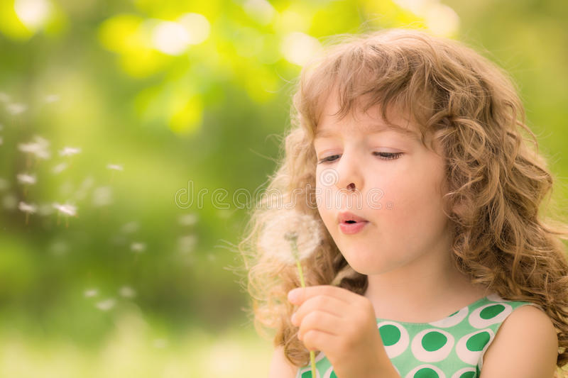 Beautiful child in spring royalty free stock photography