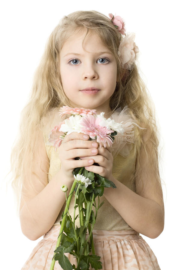 Beautiful child with spring flowers stock photography