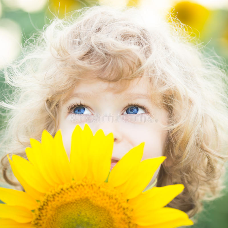 Beautiful child with sunflower royalty free stock photos