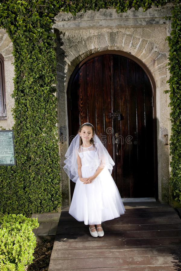 Download Beautiful Child In White Dress Outside Chapel Door Stock Image - Image: 14244815