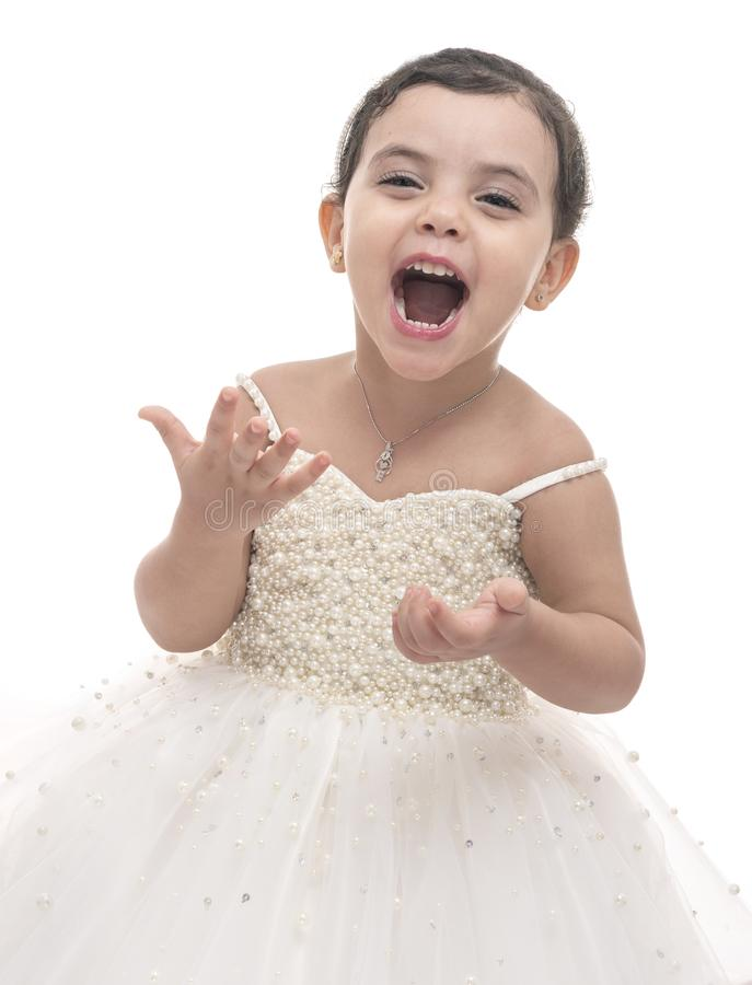 Beautiful Child in White Wedding Dress, A Girl with Happiness Expression royalty free stock photo