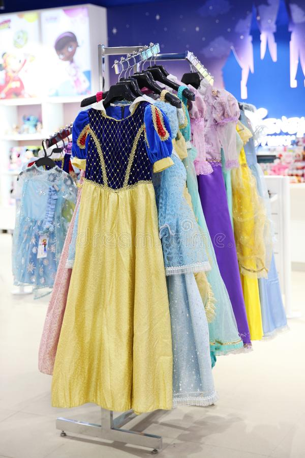 Beautiful children`s dresses on hangers of different cartoon characters from Walt Disney in the store Children`s world. Moscow. 14.12.2018 stock photos