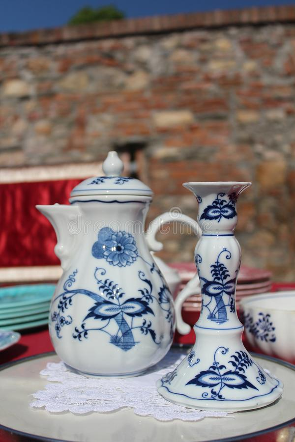 Beautiful china mug and candlestick sold at a antiques market stock images