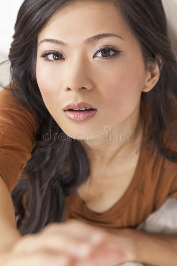 Beautiful Chinese Asian Woman Reaching to Camera stock photo