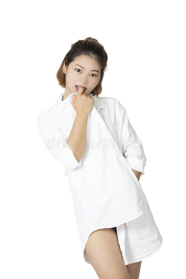Chinese woman posing in white shirt on white background royalty free stock image