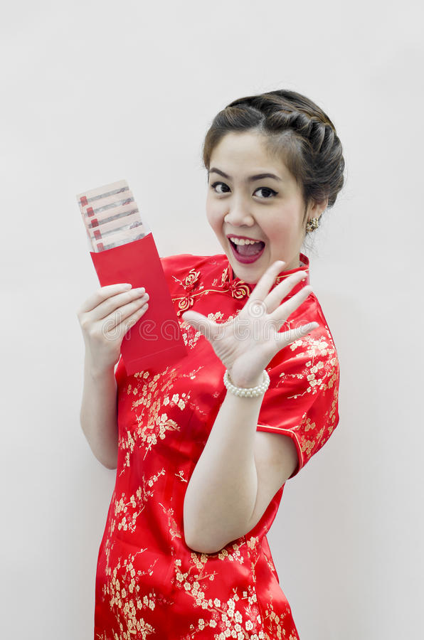 Beautiful chinese woman with tradition clothing. Smiling beautiful chinese woman with tradition clothing with copy space stock images
