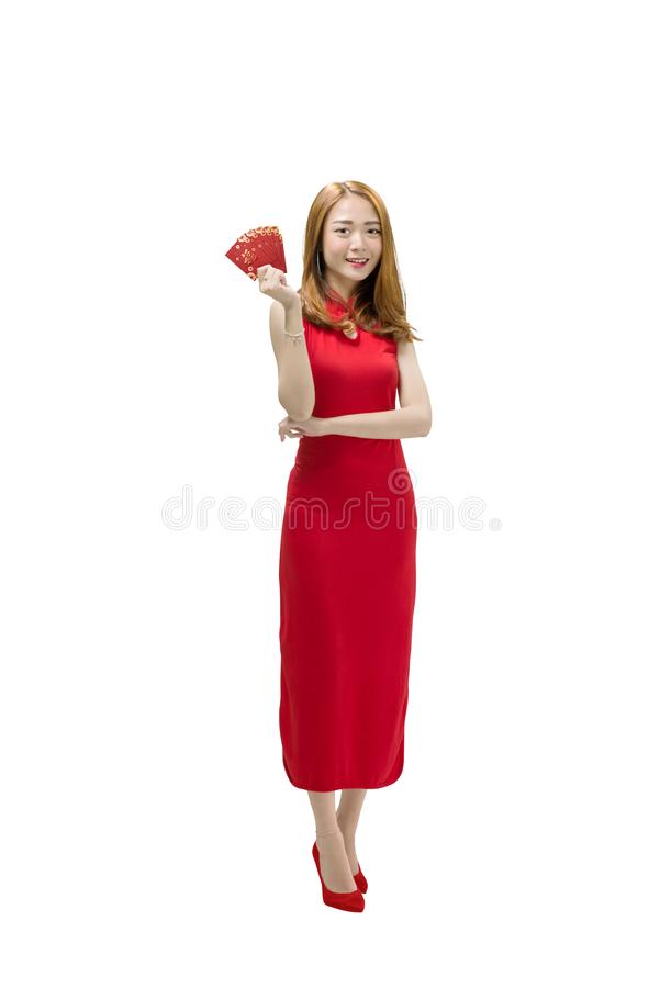 Beautiful chinese woman in traditional dress holding red envelop. Es posing isolated over white background royalty free stock photography