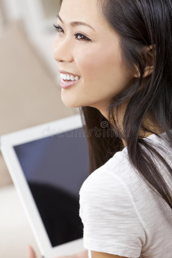 Beautiful Chinese Woman Using Tablet Computer Royalty Free Stock Photography