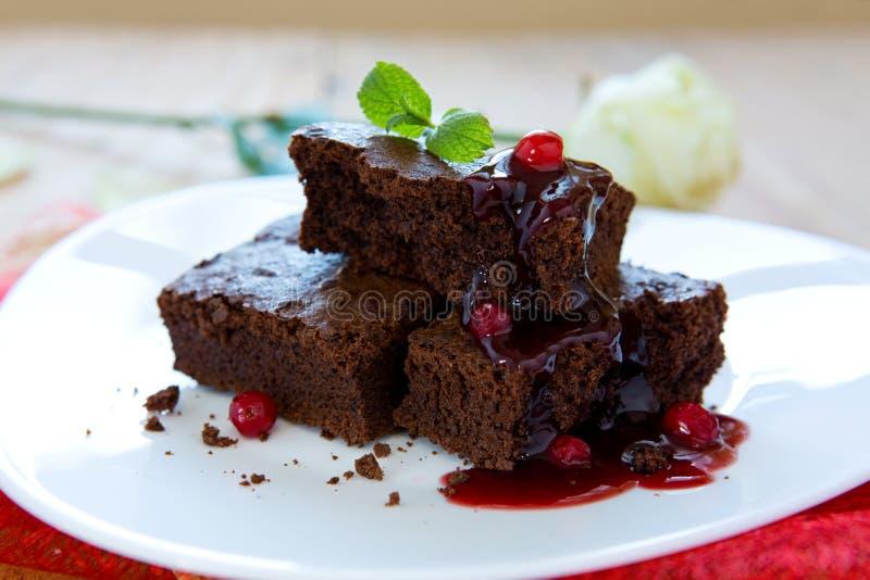 Beautiful chocolate cake with fresh berry . Beautiful chocolate cake with fresh berry and rose.Dessert - Chocolate Cake with Fresh berry and syrup royalty free stock photo