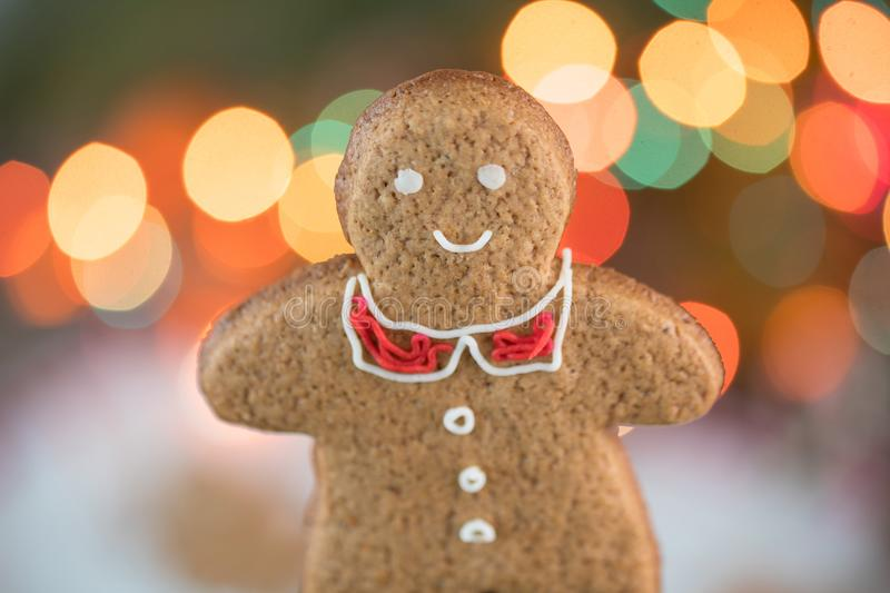 Beautiful Christmas background with gingerbread men. Merry Christmas Beautiful bokeh of glowing lights garlands. royalty free stock images