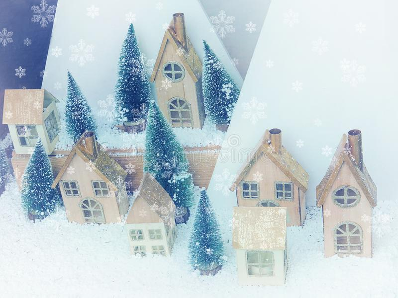 Beautiful Christmas background greeting card. Winter scenery snow forest and houses. New Year royalty free stock images