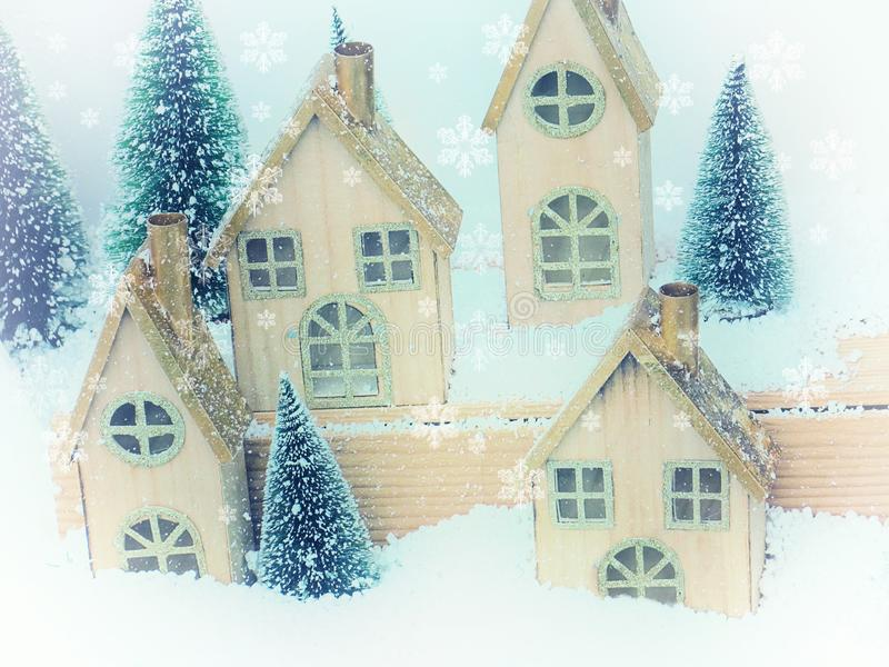 Beautiful Christmas background greeting card. Winter scenery snow forest and houses. New Year stock images