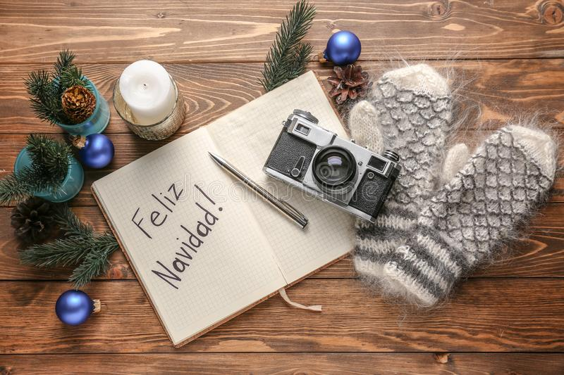 Beautiful Christmas composition with notebook and photo camera on wooden table royalty free stock photos