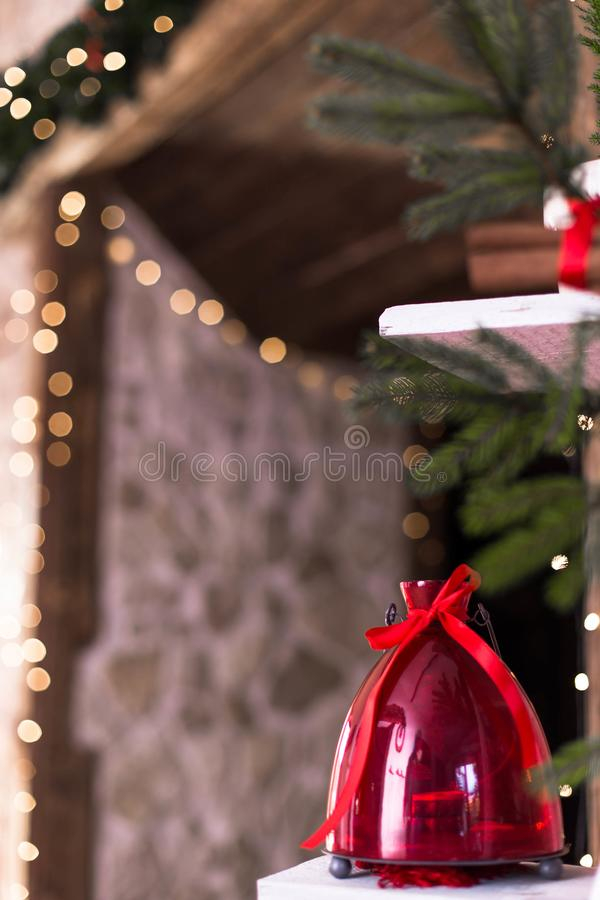 Beautiful Christmas composition with red lantern and bokeh lights in the background. Moody wooden rustic photo royalty free stock images