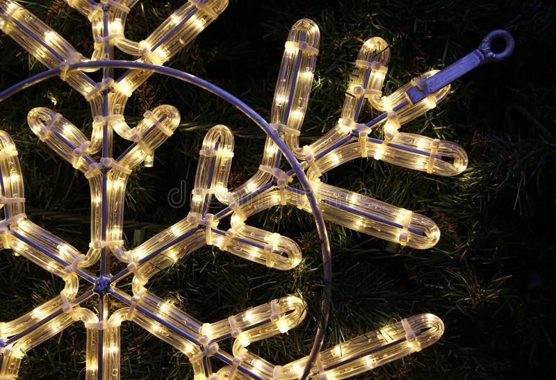 Close-up of bright glowing led christmas snowflake. Beautiful christmas decoration, close-up of bright glowing led snowflake royalty free stock images