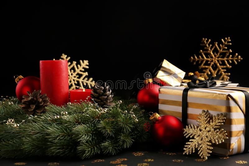 Beautiful Christmas decorations with gift boxes on dark background royalty free stock photo