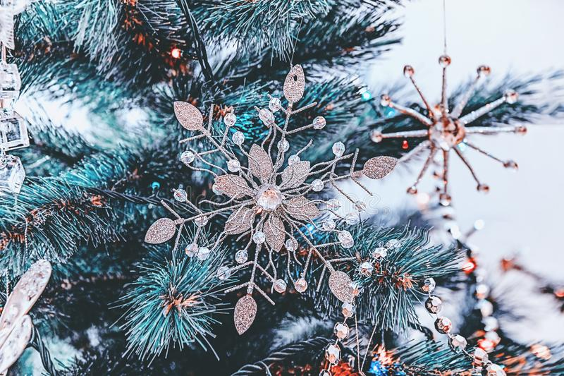 Beautiful Christmas decorations in the shape of a large white Christmas star hanging on a Christmas tree. Home decoration for. Christmas and New Year royalty free stock photos