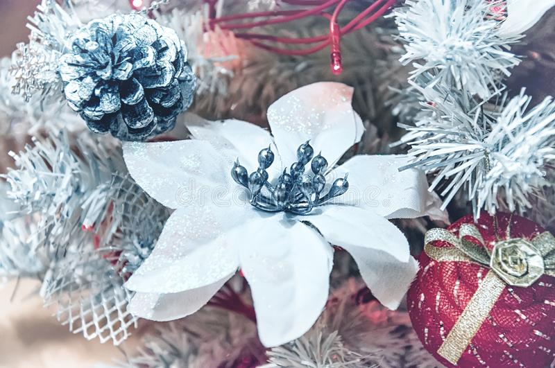 Beautiful Christmas decorations in the shape of a large white flower hanging on the Christmas tree. Home decoration for Christmas.  stock photography