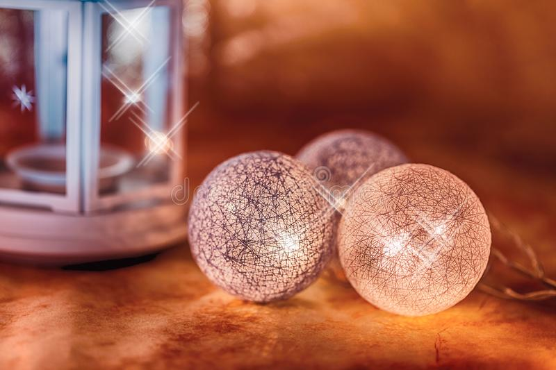 Beautiful Christmas decorations and white lamp in the shape of heart on orange hot background stock photography