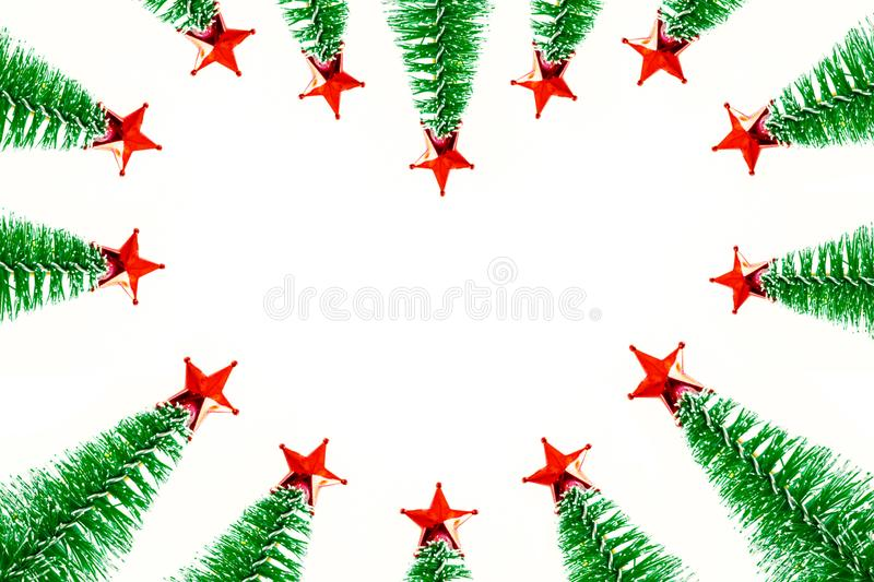 Beautiful Christmas frame from green pine tree ornament and red star. love shape border. Isolated on white background royalty free illustration