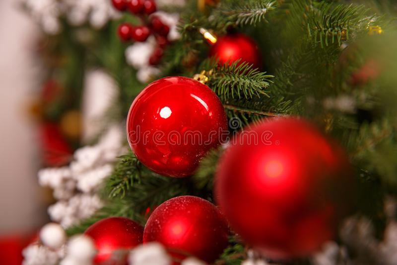 Beautiful Christmas fur-tree decorated with New Year`s toys royalty free stock images