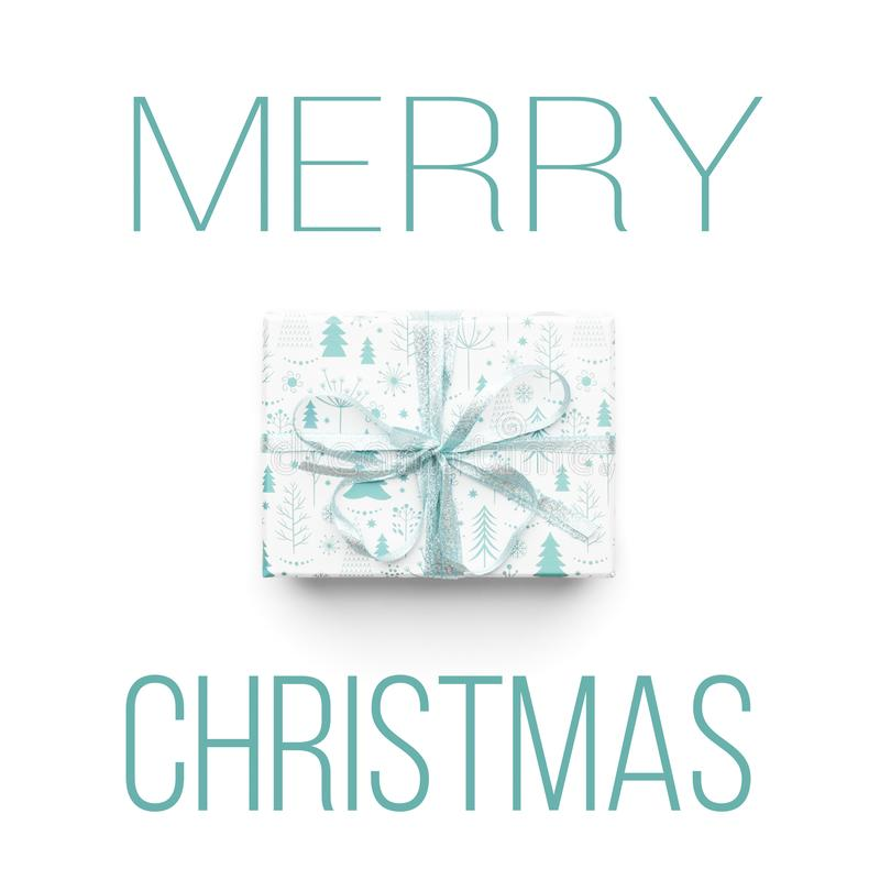 Beautiful christmas gift isolated on white background. Turquoise colored wrapped xmas box. Modern gift wrapping. royalty free stock photo
