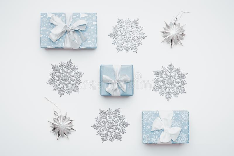 Beautiful christmas gifts and silver snowflakes isolated on white background. Christmas composition. royalty free stock photo