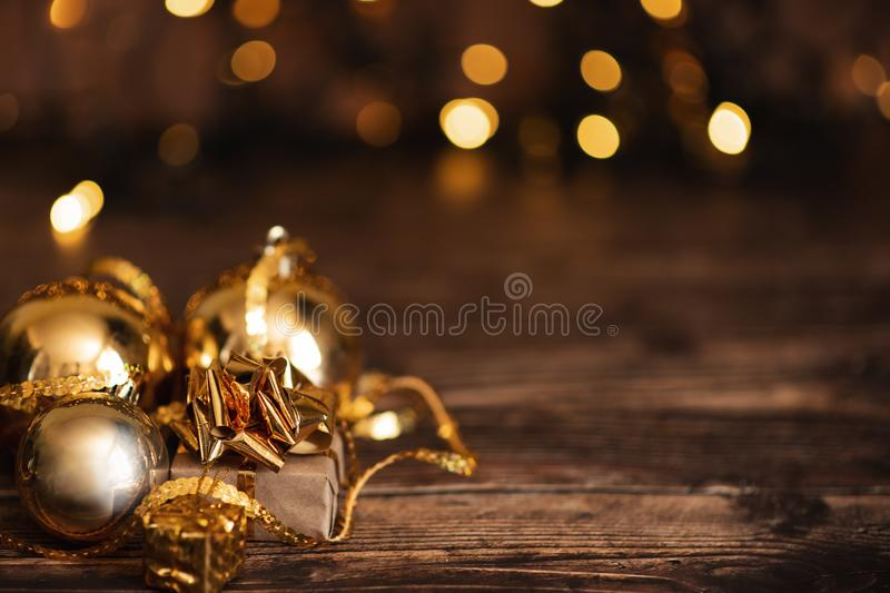 Beautiful christmas golden silver deco baubles with gifts on dark black background. Flat lay design. Copy Space. Horizontal royalty free stock photos