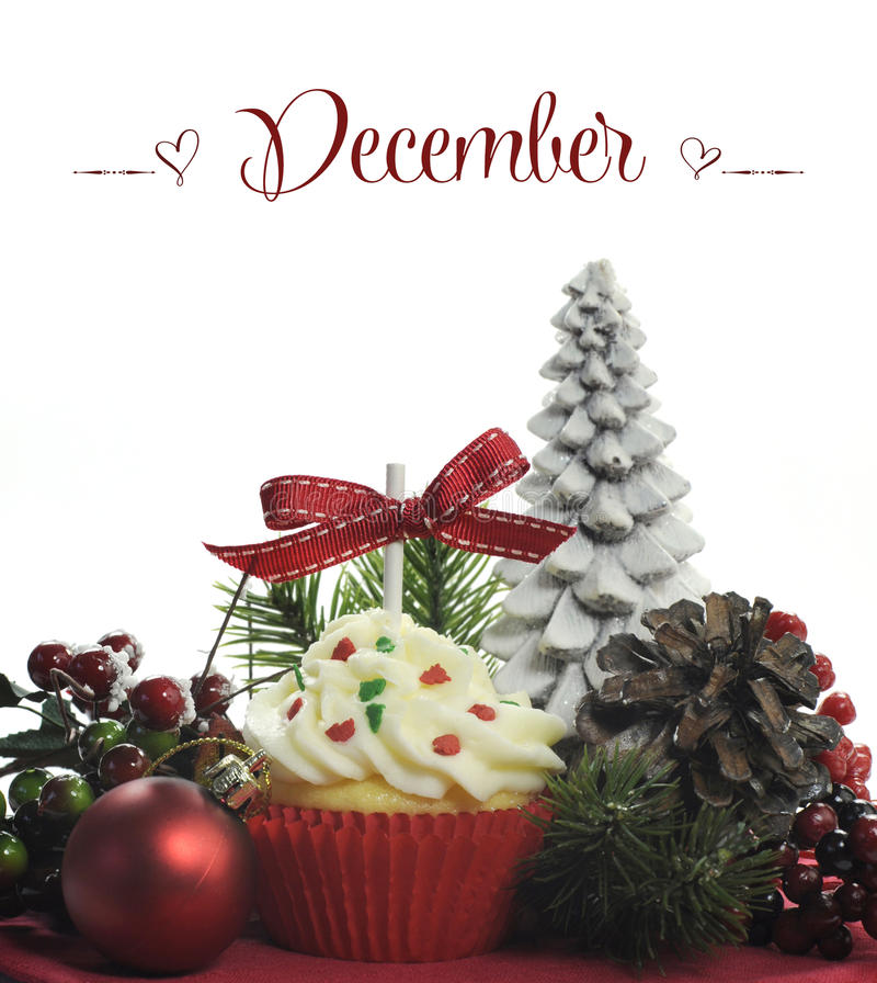 Free Beautiful Christmas Holiday Theme Cupcake With Seasonal Flowers And Decorations For The Month Of December Stock Images - 40685954