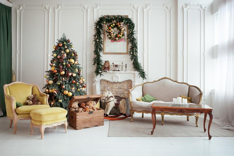 Beautiful Christmas interior. New year decoration. Living room with fireplace royalty free stock photos