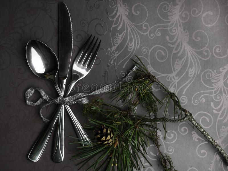 Beautiful Christmas table setting, festive serving cutlery with cone, branch. Christmas and New Year holidays background. Beautiful Christmas, New year table stock photos