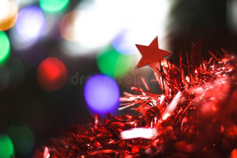 Beautiful Christmas red star on background of bokeh garlands. Christmas theme design. Beautiful Christmas red star on a background of bokeh garlands. Christmas stock photos