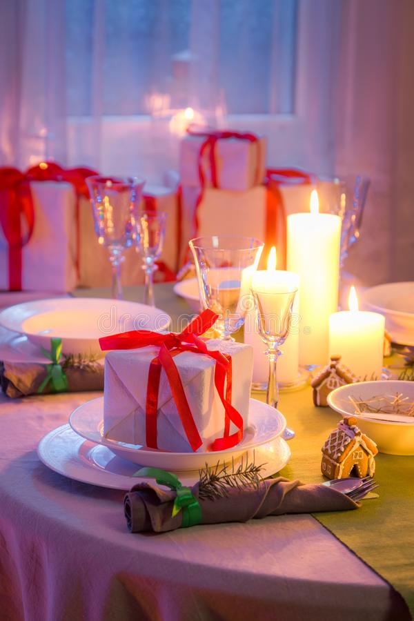 Beautiful Christmas table setting with candles and gingerbread stock photos