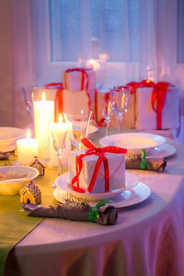Beautiful Christmas table setting with candles and gingerbread royalty free stock images