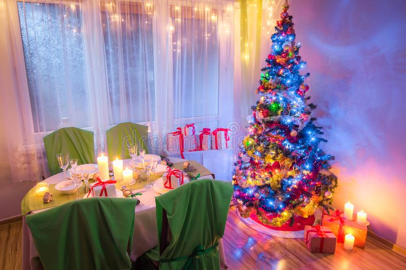 Beautiful Christmas table setting for Christmas eve in frosty evening stock images