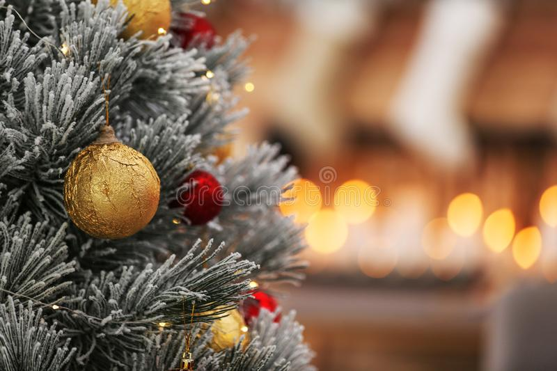 Beautiful Christmas tree decorated with balls against blurred festive lights. Space for text. Beautiful Christmas tree decorated with balls against blurred stock image