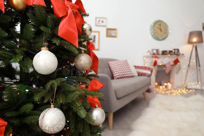 Beautiful Christmas tree in living room. Beautiful Christmas tree in decorated living room stock photography
