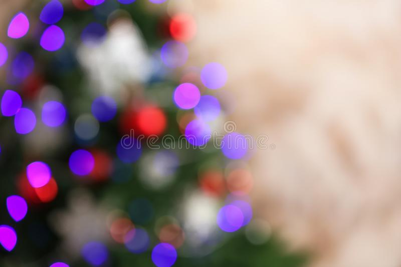 Beautiful Christmas tree with lights against brown background. Space for text stock photo